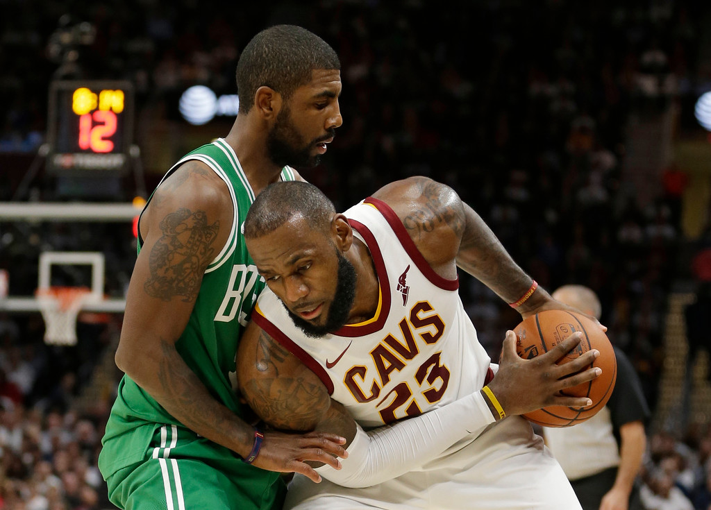 . Cleveland Cavaliers\' LeBron James, right, tries to get past Boston Celtics\' Kyrie Irving in the second half of an NBA basketball game, Tuesday, Oct. 17, 2017, in Cleveland. The Cavaliers won 102-99. (AP Photo/Tony Dejak)