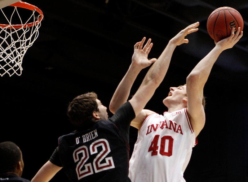 . Indiana Hoosiers forward Cody Zeller (R) shoots over Temple Owls forward Jake O\'Brien (L) during the first half of their third round NCAA tournament basketball game in Dayton, Ohio March 24, 2013.   REUTERS/Matt Sullivan