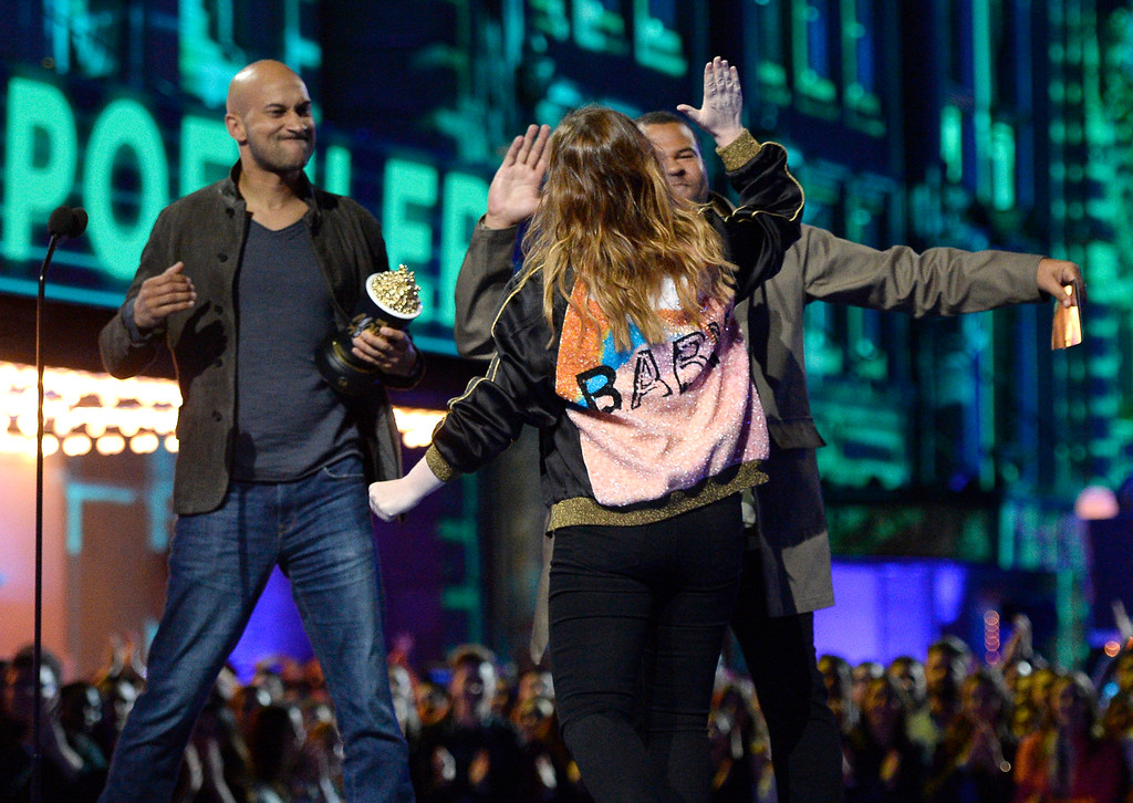 . Keegan-Michael Key, from left, and Jordan Peele present the award for best virtual performance to Amy Poehler at the MTV Movie Awards at Warner Bros. Studio on Saturday, April 9, 2016, in Burbank, Calif. (Kevork Djansezian/Pool Photo via AP)