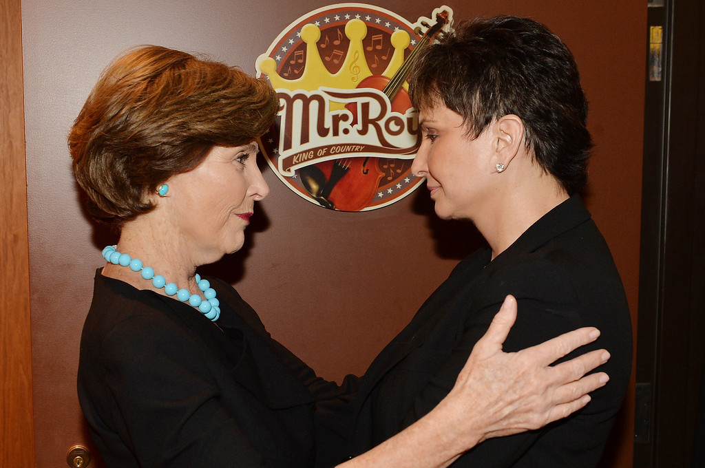 . Former US First Lady Laura Bush (L) and Nancy Jones attend the funeral service for George Jones at The Grand Ole Opry on May 2, 2013 in Nashville, Tennessee. Photo by Rick Diamond/Getty Images for GJ Memorial)