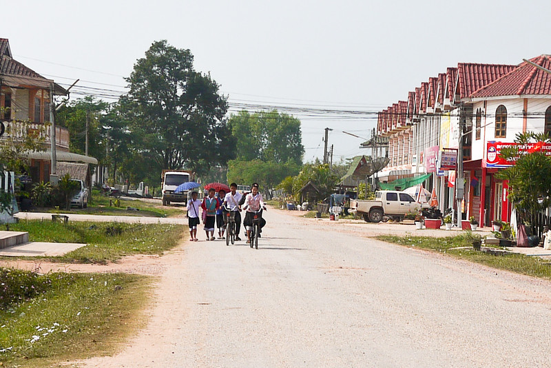 School lets out in Hongsa, Laos and the children travel home en masse.