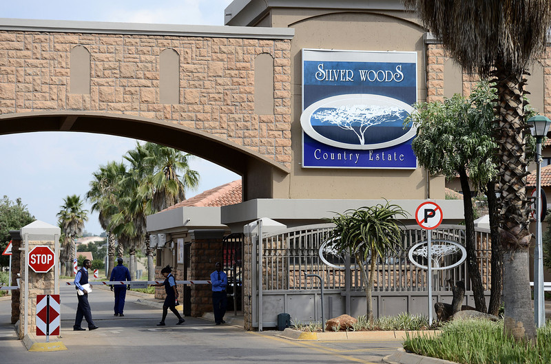 . This picture taken on February 14, 2013 shows the main entrance of the estate where South Africa\'s Olympic sprinter Oscar Pistorius lives in Pretoria East. Pistorius has been taken into police custody after allegedly shooting dead his model girlfriend having mistaken her for an intruder at his upscale home.  STEPHANE DE SAKUTIN/AFP/Getty Images