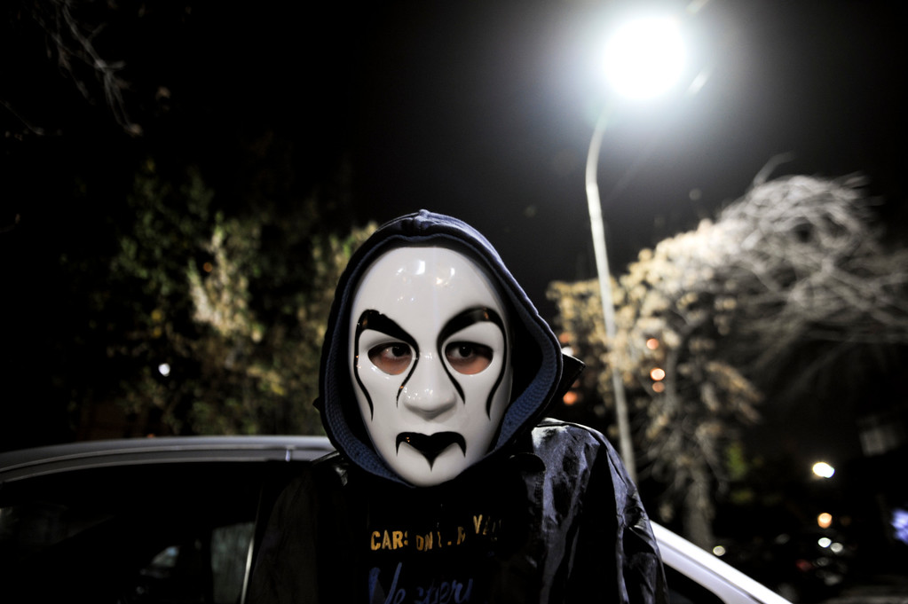 . A child wearing a mask participates in a annual Halloween party in central Pristina, on October 31, 2013. ARMEND NIMANI/AFP/Getty Images