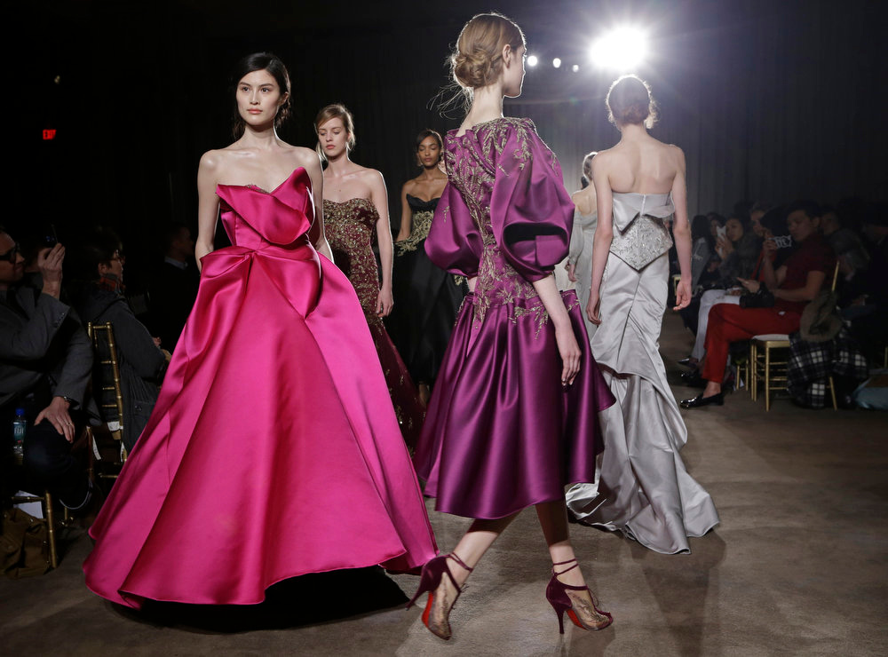Description of . Models walk the runway during the Marchesa Fall 2013 fashion show Fashion Week in New York on Wednesday, Feb. 13, 2013.  (AP Photo/Kathy Willens)