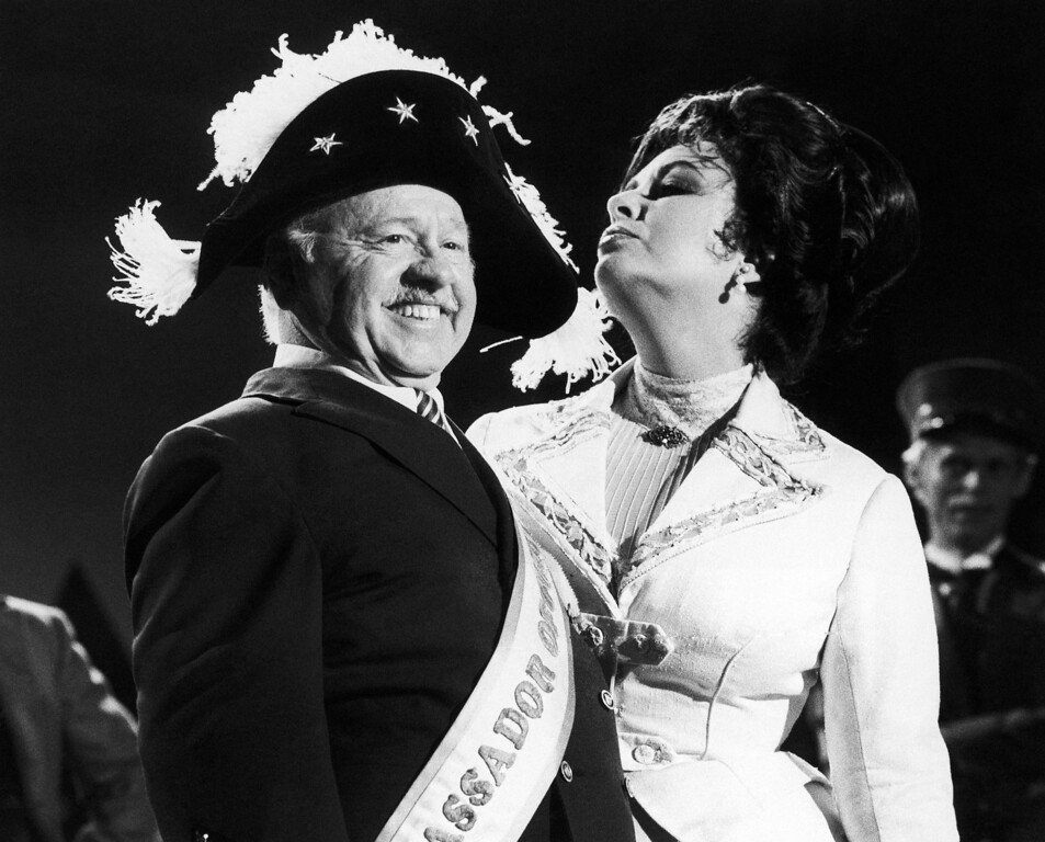 . In this Thursday, Aug. 27, 1981, file photo, veteran comic Mickey Rooney wears a Napoleonic-era hat as he tapes an ìI love New Yorkî television commercial with British-American actress Elizabeth Taylor, in New York.  (AP Photo/GPB, File)