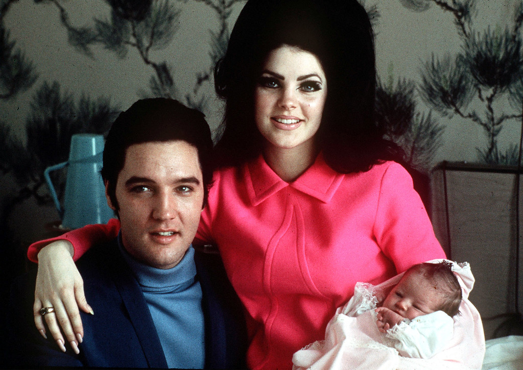 . ** FILE ** Elvis Presley poses with wife Priscilla and daughter Lisa Marie, in a room at Baptist hospital in Memphis, Tenn., February 05, 1968. August 16, 2007 marks the 30th anniversary of Presley\'s death. (AP Photo)