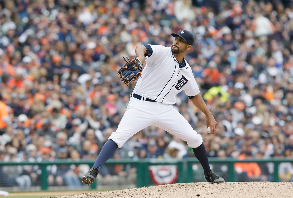 . Detroit Tigers starting pitcher David Price throws during the fifth inning of an opening day baseball game against the Minnesota Twins in Detroit, Monday, April 6, 2015. (AP Photo/Carlos Osorio)