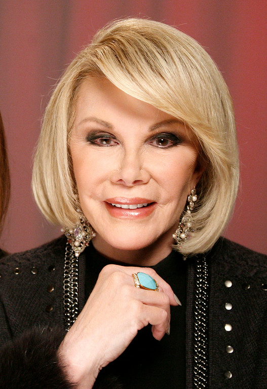 """. FILE - In this Jan. 18, 2011 file photo, TV personality Joan Rivers poses for a portrait in New York.  Rivers, along with Regis Philbin, Rhea Perlman and Kevin Nealon will be guest-starring on the TV Land series, \""""Hot in Cleveland.\""""  (AP Photo/Jeff Christensen, file)"""