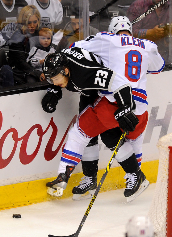 . The Rangers\' Kevin Klein checks the Kings\' Dustin Brown in game two of the Stanley Cup Final, Saturday, June 7, 2014, at Staples Center. (Photo by Michael Owen Baker/Los Angeles Daily News)
