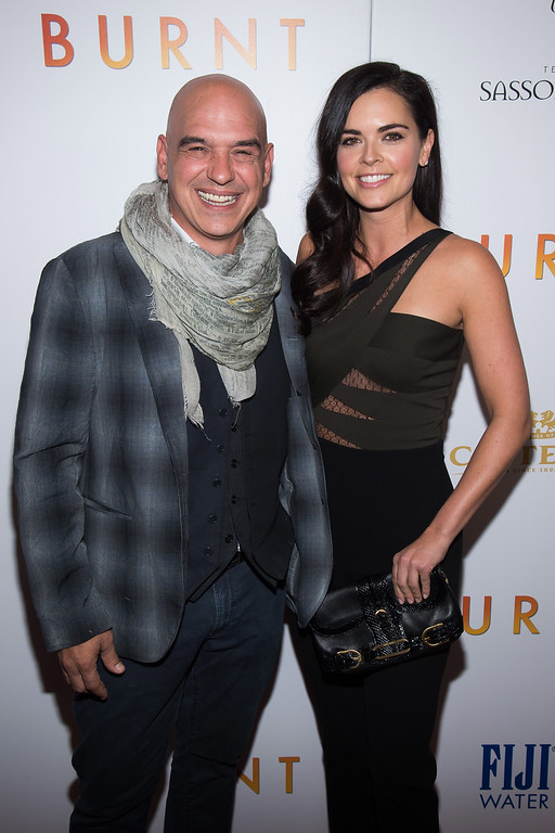 ". Michael Symon and Katie Lee attend the premiere of ""Burnt\"" at the Museum of Modern Art on Tuesday, Oct. 20, 2015, in New York. (Photo by Charles Sykes/Invision/AP)"