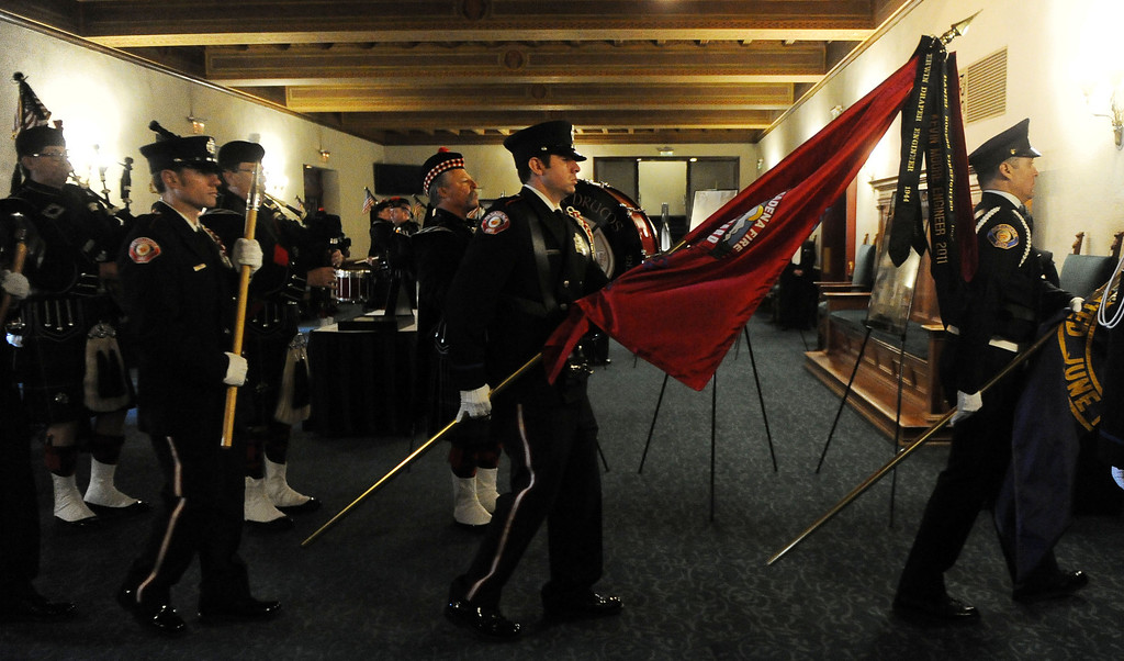 . Color guard makes their way into the auditorium during a celebration of life service for former Pasadena Fire dept. Capt. and California State fire marshall, John Tennant at the Pasadena Civic Auditorium in Pasadena, Calif., on Wednesday, Feb. 5, 2014. (Keith Birmingham Pasadena Star-News)