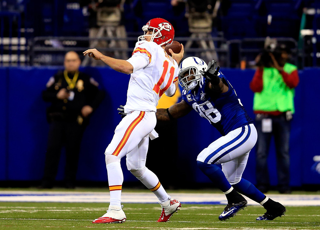 . INDIANAPOLIS, IN - JANUARY 04: Quarterback Alex Smith #11 of the Kansas City Chiefs is pressured by outside linebacker Robert Mathis #98 of the Indianapolis Colts in the second quarter during a Wild Card Playoff game at Lucas Oil Stadium on January 4, 2014 in Indianapolis, Indiana.  (Photo by Rob Carr/Getty Images)