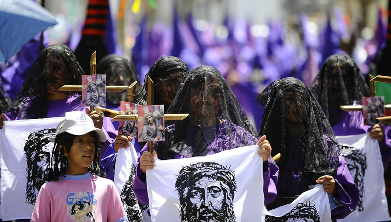""". Penitents take part in the \""""Jesus del Gran Poder\"""" procession during Holy Week celebrations in Quito on April 18, 2014. Thousands of Christian around the world mark Holy Week with a series of deeply symbolic rituals commemorating Jesus\' crucifixion and resurrection three days later on the holiest day of the Christian calendar, Easter Sunday. (RODRIGO BUENDIA/AFP/Getty Images)"""