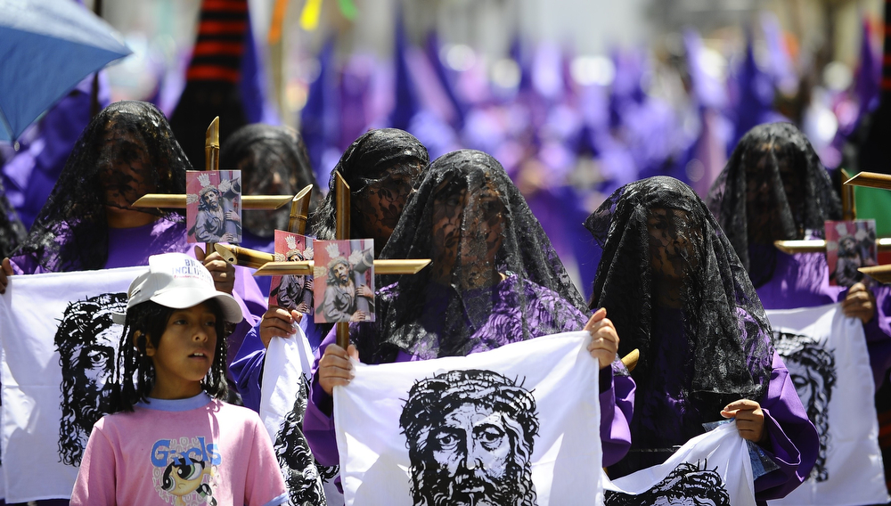 ". Penitents take part in the ""Jesus del Gran Poder\"" procession during Holy Week celebrations in Quito on April 18, 2014. Thousands of Christian around the world mark Holy Week with a series of deeply symbolic rituals commemorating Jesus\' crucifixion and resurrection three days later on the holiest day of the Christian calendar, Easter Sunday. (RODRIGO BUENDIA/AFP/Getty Images)"