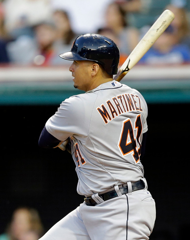 . Detroit Tigers\' Victor Martinez hits a two-RBI single off Cleveland Indians starting pitcher Trevor Bauer in the fourth inning of a baseball game, Monday, June 22, 2015, in Cleveland. Anthony Gose and Ian Kinsler scored on the play. (AP Photo/Tony Dejak)