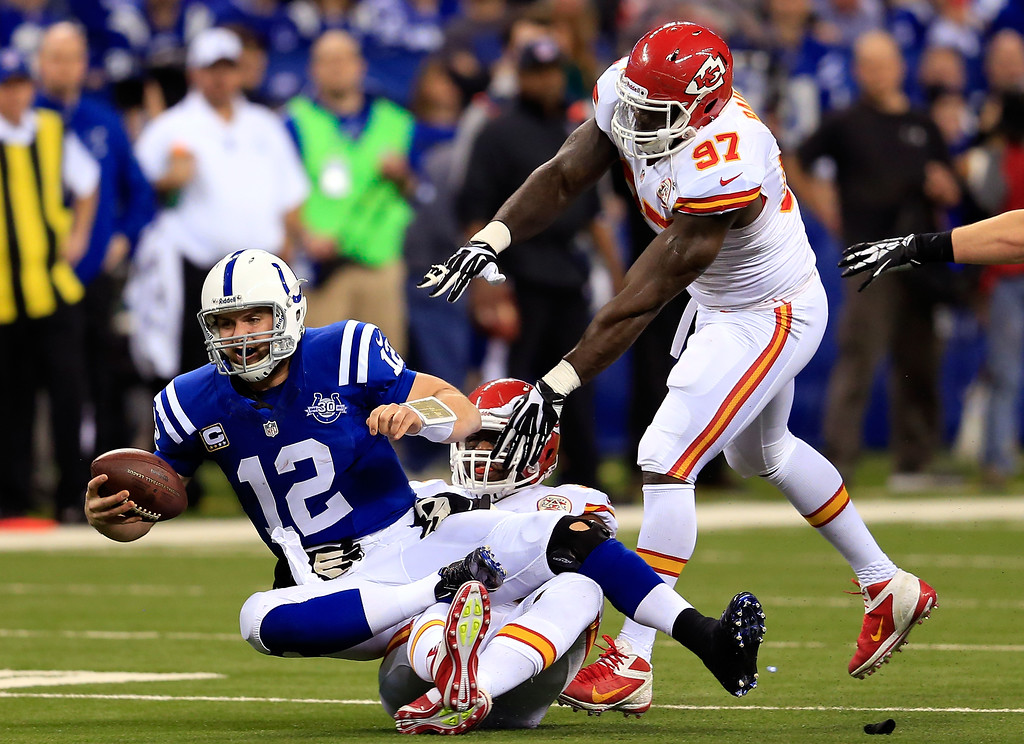 . INDIANAPOLIS, IN - JANUARY 04:  Quarterback Andrew Luck #12 of the Indianapolis Colts is sacked by outside linebacker Justin Houston #50 of the Kansas City Chiefs during a Wild Card Playoff game at Lucas Oil Stadium on January 4, 2014 in Indianapolis, Indiana.  (Photo by Rob Carr/Getty Images)
