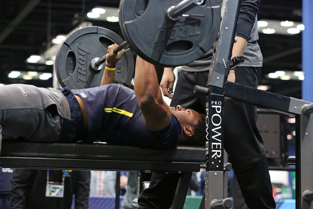. Texas A&M defensive end Myles Garrett performs in the bench press at the 2017 NFL football scouting combine Saturday, March 4, 2017, in Indianapolis. (AP Photo/Gregory Payan)