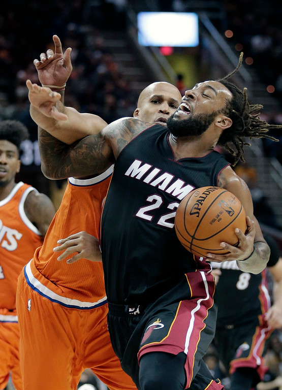 . Cleveland Cavaliers\' Richard Jefferson fouls Miami Heat\'s Derrick Williams, right, in the second half of an NBA basketball game Friday, Dec. 9, 2016, in Cleveland. The Cavaliers won 114-84. (AP Photo/Tony Dejak)