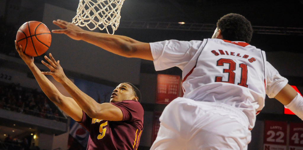 . Minnesota Golden Gophers guard Daquein McNeil (5) takes a shot in front of Nebraska Cornhuskers guard/forward Shavon Shields (31). (AP Photo/Dave Weaver)