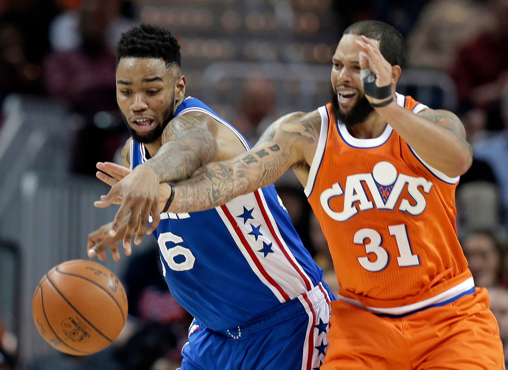 . Philadelphia 76ers\' Shawn Long, left, and Cleveland Cavaliers\' Deron Williams battle for the ball in the second half of an NBA basketball game, Friday, March 31, 2017, in Cleveland. (AP Photo/Tony Dejak)