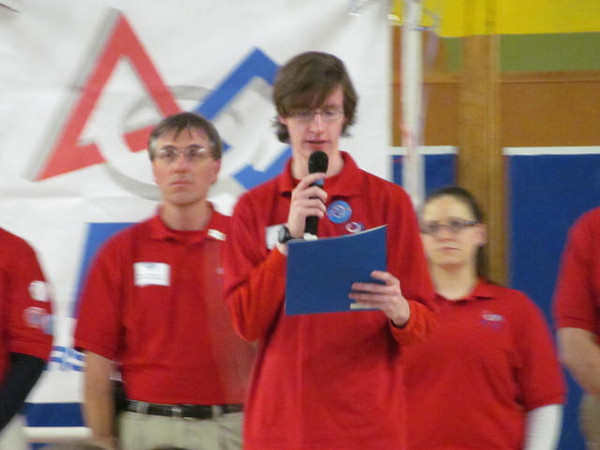 Tyler Evert, a former FLLer gives his award.