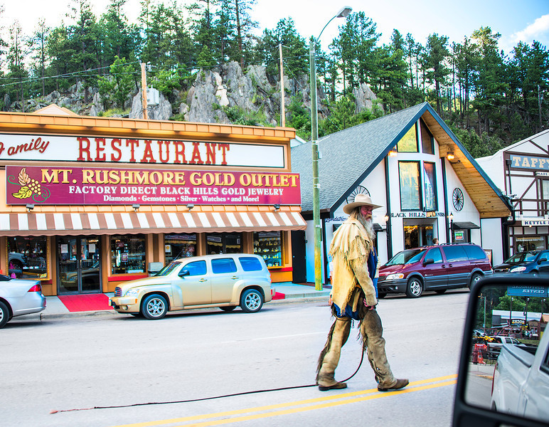 The little town at the bottom of Mount Rushmore had this guy walking straight down the middle of the road with his whip hanging out.
