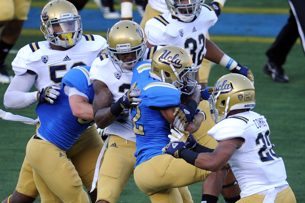 . UCLA wide receiver Roosevelt Davis (22) runs for yardage during the football spring showcase college football game in the Rose Bowl on Saturday, April 27, 2013 in Pasadena, Calif.    (Keith Birmingham Pasadena Star-News)