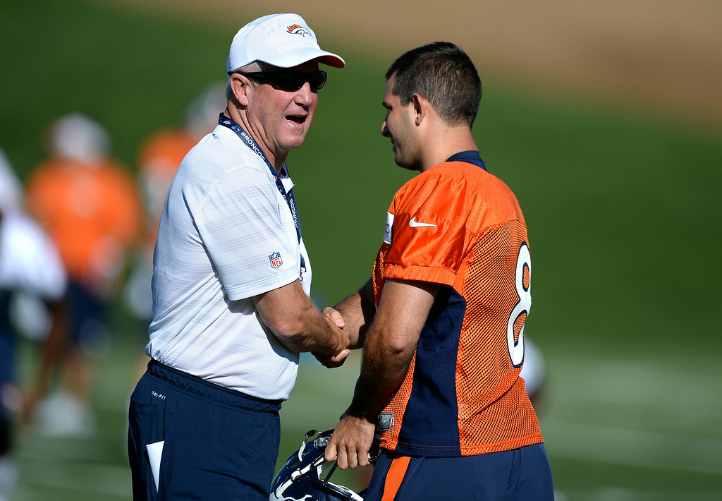. Denver Broncos head coach John Fox shakes hands with K Mitch Ewald (8) during the start of the Denver Broncos 2014 training camp July 24, 2014 at Dove Valley. (Photo by John Leyba/The Denver Post)