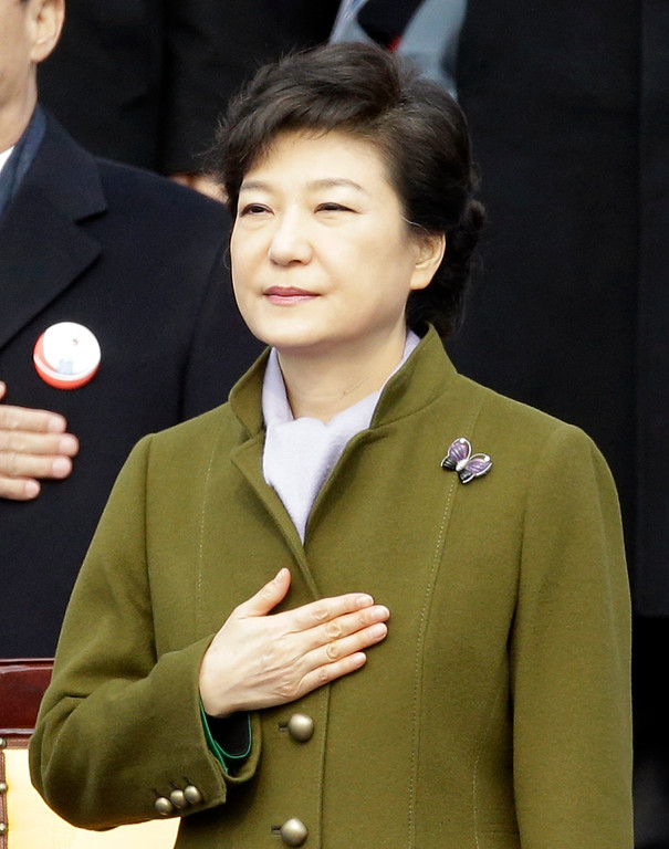 . South Korean President Park Geun-hye salutes the national flag during her inauguration ceremony at the National Assembly in Seoul, South Korea, Monday, Feb. 25, 2013. Park became South Korea\'s first female president Monday, returning to the presidential mansion where she grew up with her dictator father.   (AP Photo/Lee Jin-man)