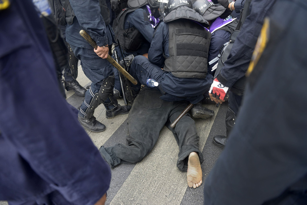 . A protestor is detained by riot police during the police operation to reclaim Phan Fah Bridge on February 18, 2014 in Bangkok, Thailand.   (Photo by Nick McGrath/Getty Images)