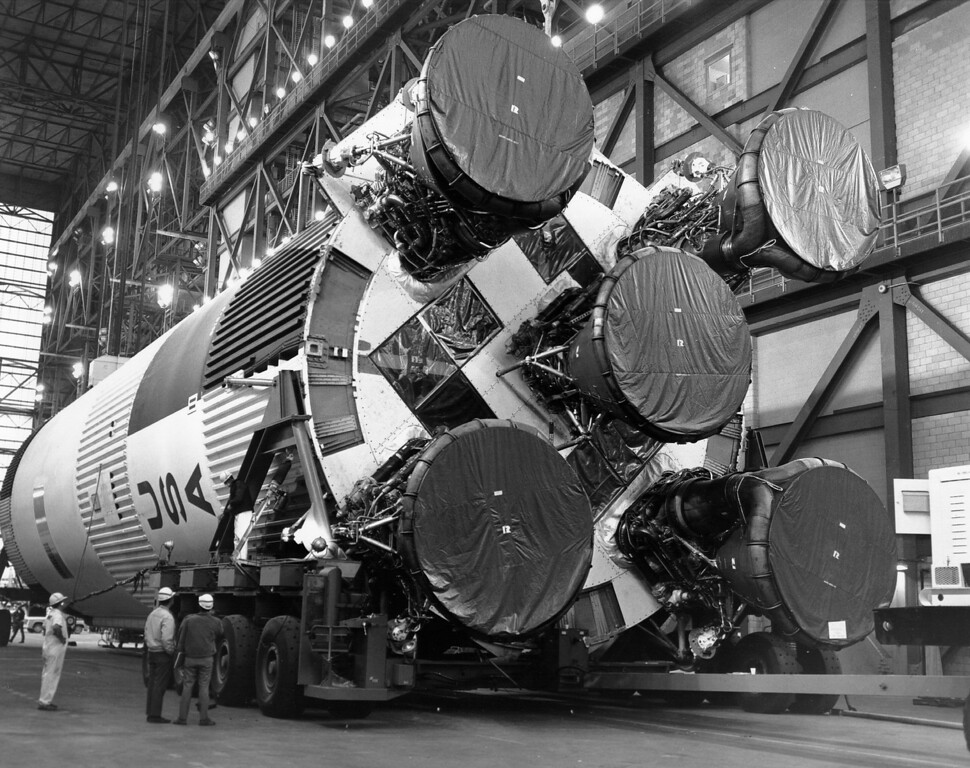 . Workers prepare the S-IC first stage in the transfer aisle of the Vehicle Assembly Building at NASA\'s Kennedy Space Center. February 21, 1969. Courtesy of the National Aeronautics and Space Administration, specifically the NASA History Office and Kennedy Space Center.