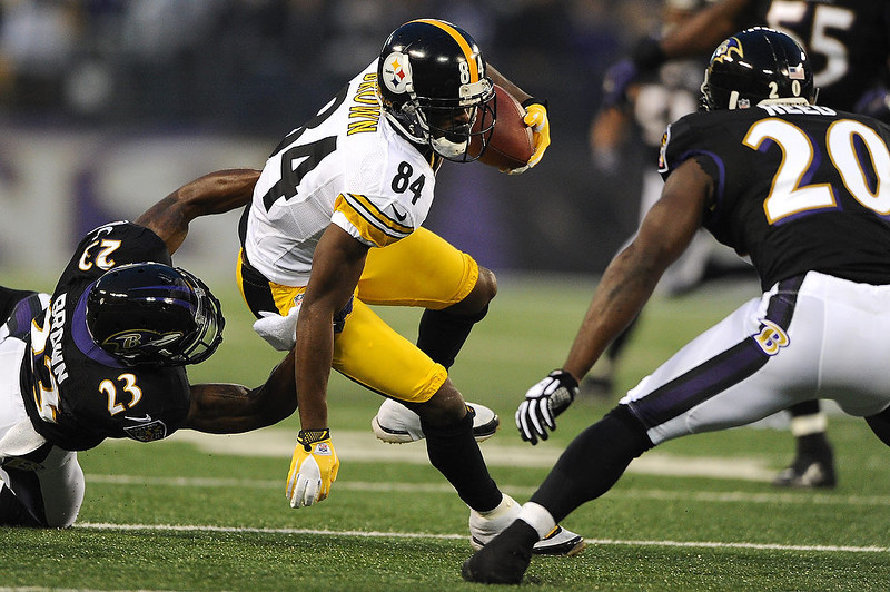 . Wide receiver Antonio Brown #84 of the Pittsburgh Steelers is pulled down by cornerback Chykie Brown #23 of the Baltimore Ravens in the first quarter at M&T Bank Stadium on December 2, 2012 in Baltimore, Maryland. (Photo by Patrick Smith/Getty Images)
