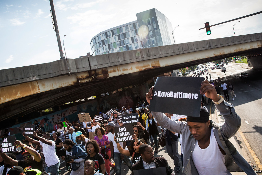 . BALTIMORE, MD - APRIL 30:  Protesters march from the Sandtown neighborhood to City Hall demanding better police accountability and racial equality following the death of Freddie Gray on April 30, 2015 in Baltimore, Maryland. Gray, 25, was arrested for possessing a switch blade knife April 12 outside the Gilmor Houses housing project on Baltimore\'s west side. According to his attorney, Gray died a week later in the hospital from a severe spinal cord injury he received while in police custody.  (Photo by Andrew Burton/Getty Images)