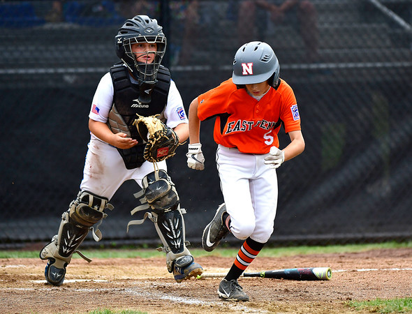 8/6/2019 Mike Orazzi | Staff Pennsylvania's Brody Rafferty (5) thrown out at first by Delawre catcher Mark Spoor (2) during their second game of the Little League Mid-Atlantic regional on Aug. 6, 2019 at Breen Field in Bristol, Ct.