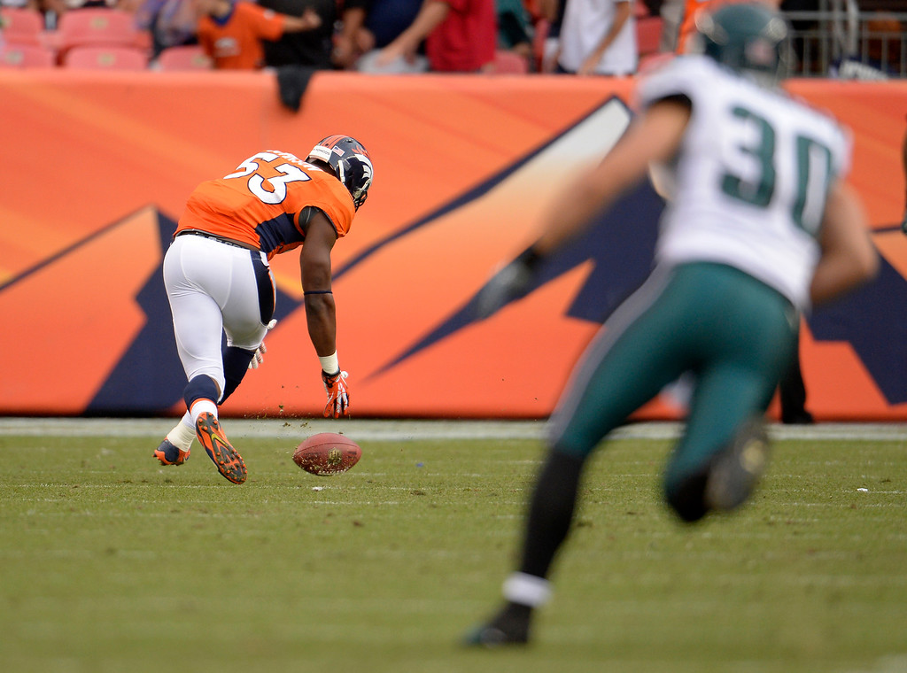 . Denver Broncos linebacker Steven Johnson (53) picks up the ball from a punt he blocked. Johnson ran it into the end zone for a touchdown. The Denver Broncos took on the Philadelphia Eagles at Sports Authority Field at Mile High in Denver on September 29, 2013. (Photo by Joe Amon/The Denver Post)