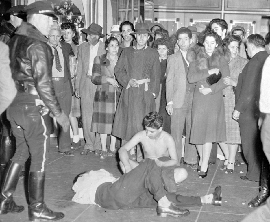 . These youths, one stripped of all his clothes and the other badly beaten, fell victim to raging bands of servicemen who scoured the streets in Los Angeles, June 20, 1943, looking for and beating zoot suited youths. The servicemen blame the zoot suited youths for numerous unprovoked assaults on their colleagues. (AP Photo)