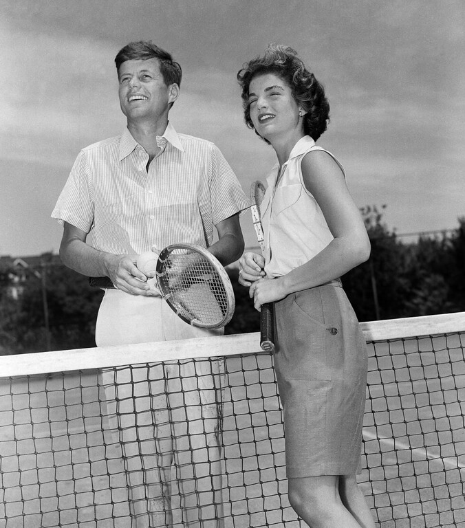 . Sen. Kennedy and his fiancee, Jacqueline Bouvier, 23, meet at the net as they prepare for a game of tennis at the Kennedy residence at Hyannis, Mass., on June 27, 1953, where they were spending the weekend. Associated Press file