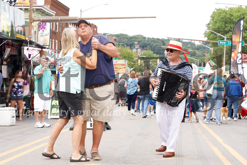 Paul and Jan Sporter seize the moment for an impromptu dance on Main Street in Butler during the city's annual Italian Festival Saturday. Hank Edwardo of Bloomfield provided musical accompaniment on the accordion. Seb Foltz/Butler Eagle