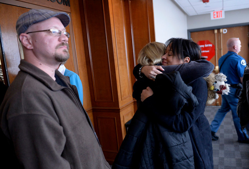. Sandi Rogers, mother of Chuck E. Cheese murder victim Ben Grant, middle, hugs friends in the hallway after hearing that a date has been set for the execution of Nathan Dunlap.  Judge William Sylvester set an execution date for Dunlap for the week of  August 18th-24th, 2013. The hearing held today was to  set a date for the execution of convicted murderer Nathan Dunlap at the Arapahoe County Court in Division court room 408  in Centennial, CO on May 1, 2013.   Judge William Sylvester is the presiding judge on the case.  (Photo by Helen H. Richardson/The Denver Post)