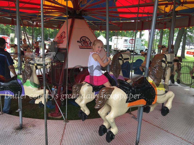 Charley Michaels, 6, smiles on a merry-go-round ride.
