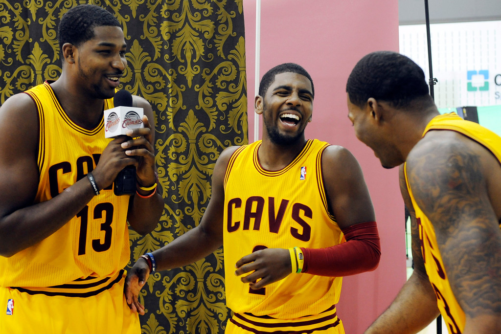 . Cleveland Cavaliers forward Tristan Thompson (13) jokes with guard Kyrie Irving (2) and Alonzo Gee during their NBA basketball media day at the team\'s training facility in Independence, Ohio, Monday, Oct. 1, 2012. (AP Photo/Phil Long)
