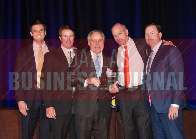 Seth kelly, Travis Sapaugh, Nathan Lawrence and Ryan Keiser accept their Industrial Transaction, Brokers of the Year award from Bill Shaddock, center, of Best Real Estate Deals presenting sponsor Capital Title.
