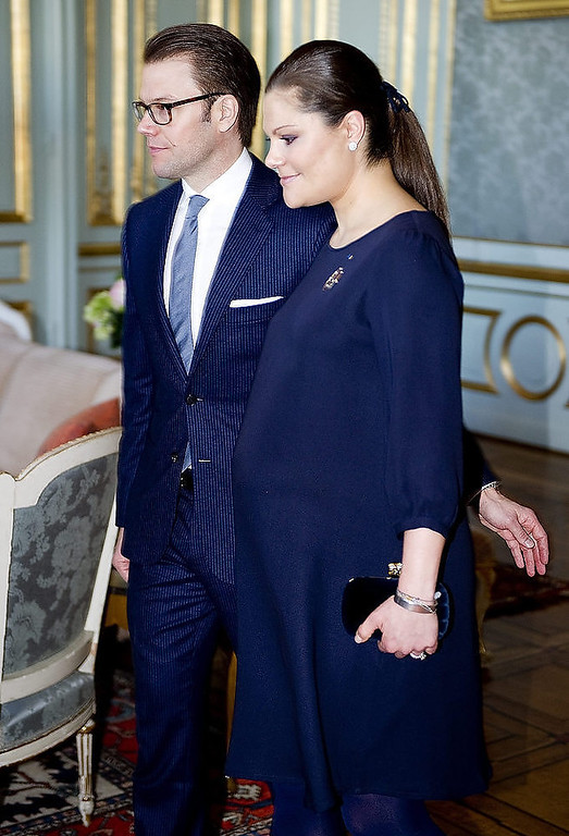 . Pregnant Sweden\'s Crown Princess Victoria (R) and Prince Daniel arrive for a lunch at Stockholm\'s Royal Palace on February 21, 2012.  PONTUS LUNDAHL/AFP/Getty Images