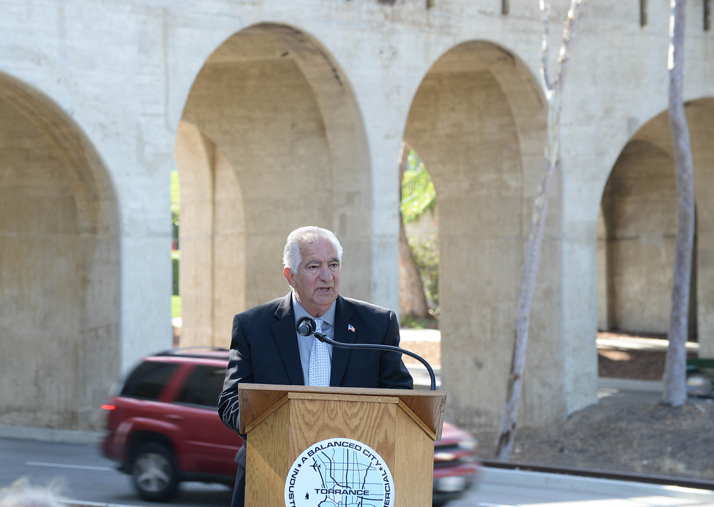 . The Torrance historical railroad bridge was rededicated and renamed the Pacific Electric Railway El Prado Bridge in a ceremony Thursday.  Mayor Frank Scotto speaks at the ceremony with the bridge in the background. 20130523 Photo by Steve McCrank / Staff Photographer