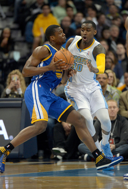 . DENVER, CO - APRIL 16: Golden State Warriors forward Harrison Barnes (40) drives on Denver Nuggets forward Quincy Miller (30) during the first quarter April 16, 2014 at Pepsi Center. (Photo by John Leyba/The Denver Post)