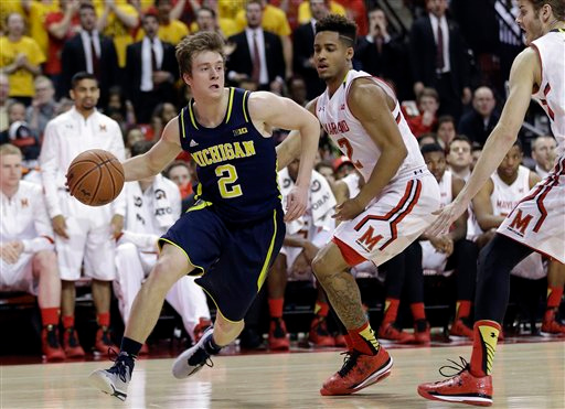 . Michigan guard Spike Albrecht, left, drives around Maryland guard Melo Trimble in the first half of an NCAA college basketball game, Saturday, Feb. 28, 2015, in College Park, Md. (AP Photo/Patrick Semansky)