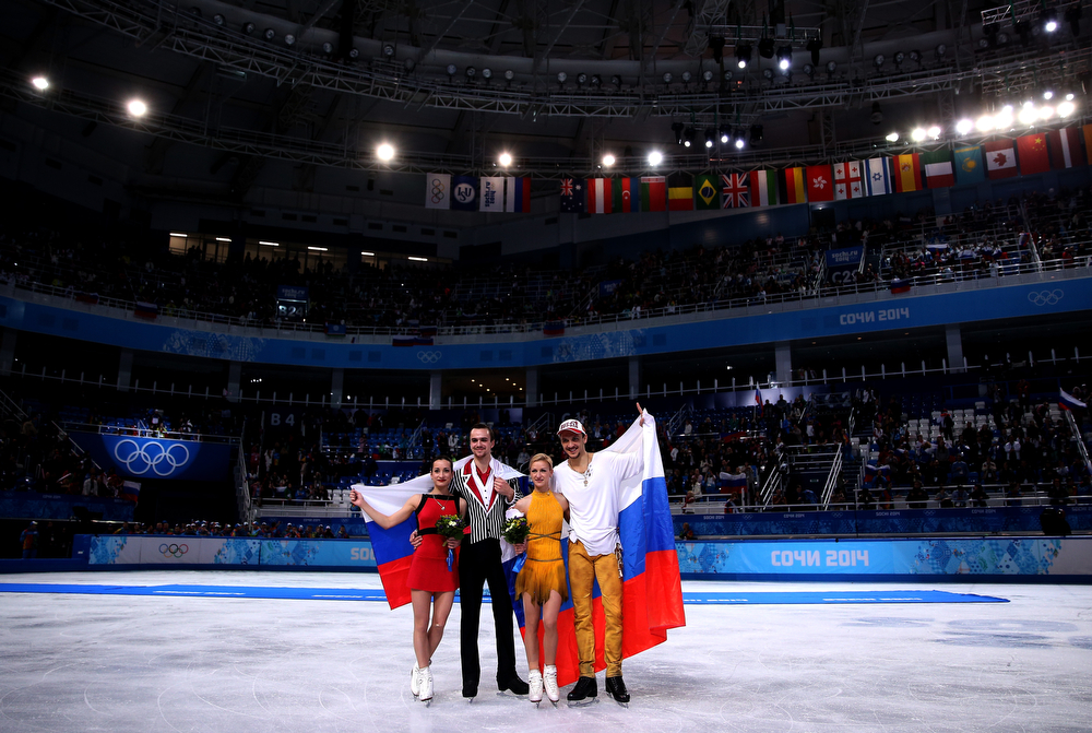 . (L-R) Silver medalists Ksenia Stolbova and Fedor Klimov of Russia, gold medalists Tatiana Volosozhar and Maxim Trankov of Russia pose during the flower ceremony for the Figure Skating Pairs event during day five of the 2014 Sochi Olympics at Iceberg Skating Palace on February 12, 2014 in Sochi, Russia.  (Photo by Matthew Stockman/Getty Images)