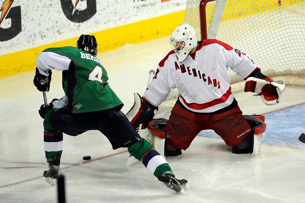 . DENVER, CO - MAY 2: Garett Bembridge (41) of the Denver Cutthroats has his shot blocked by Allen Americans goalie Bryan Pitton  during the second period of game 1 of the Ray Miron Presidents Cup Finals at the Denver Coliseum in Denver, Colorado on May 2, 2014. (Photo by Seth McConnell/The Denver Post)