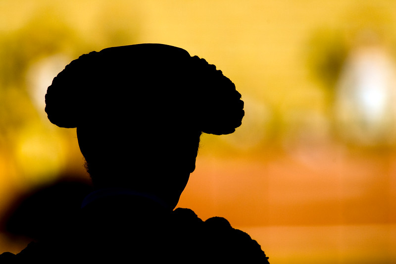"""Silhouette of a bullfighter's head wearing the traditional hat or """"montera"""", Real Maestranza bullring, Seville, autonomous community of Andalusia, southern Spain"""
