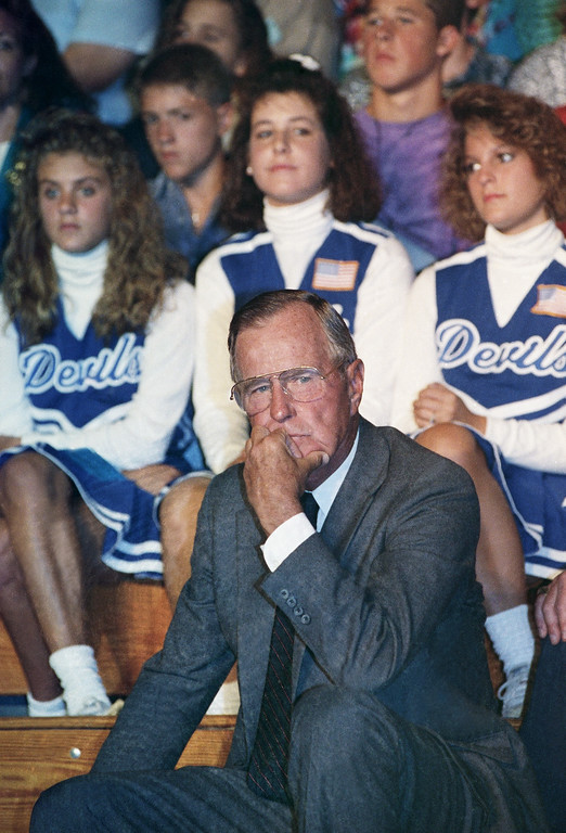 . U.S. President George H. Bush talks with Maine Gov. John McKernan prior to delivering an Education 200 speech to members of the Maine education community and students at the Lewiston Comprehensive High School in Lewiston, Maine, Tuesday, Sept. 4, 1991. (AP Photo/Greg Gibson)